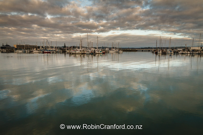 Sunrise is reflected on the water at Ahuriri Harbour.