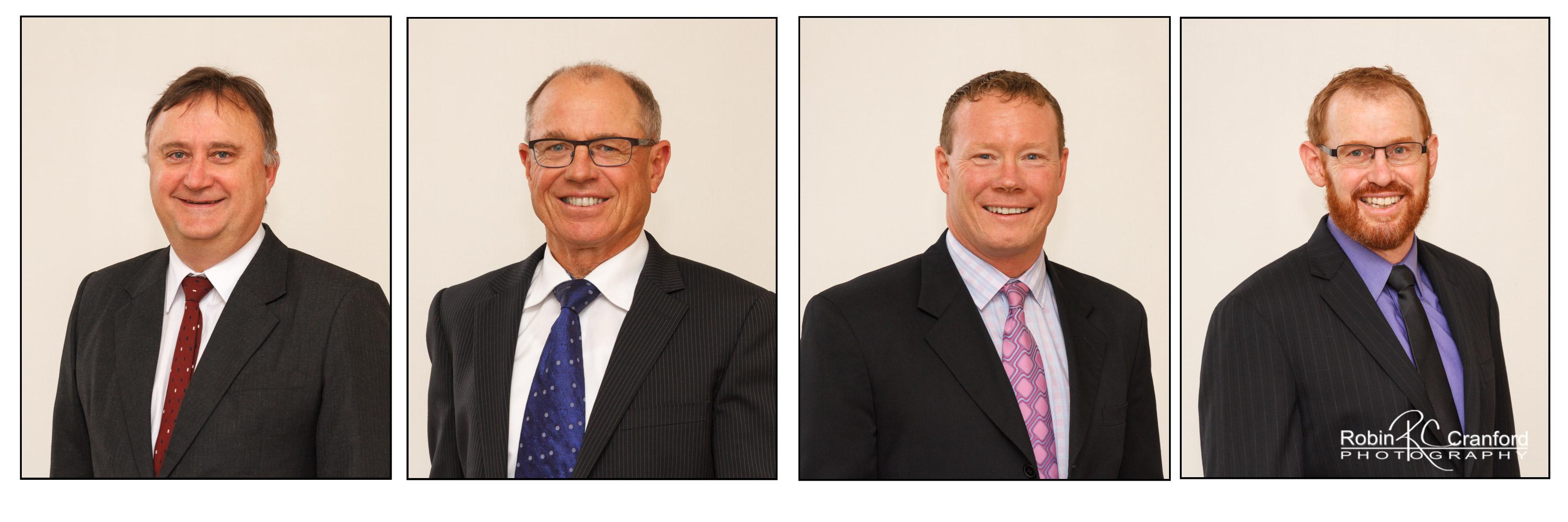 Corporate headshots.  Men in suits.