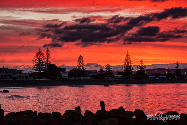A fiery red sunset over Westshore, Hawke's Bay.